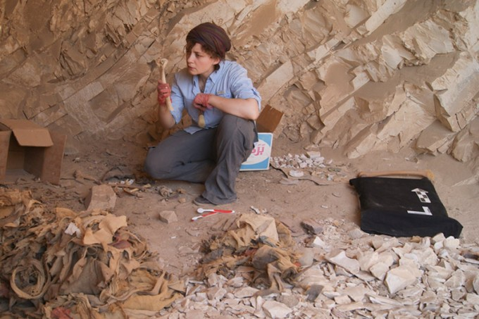 Stanford postdoctoral scholar Anne Austin examines the skeletal remains of ancient Egyptians found in the burial sites of Deir el-Medina. (Photo courtesy of Anne Austin)